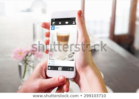 Composite image of hand holding smartphone Stock photo © wavebreak_media