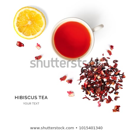 glass cup hibiscus tea with hibiscus flower and petals isolated stock photo © tetkoren