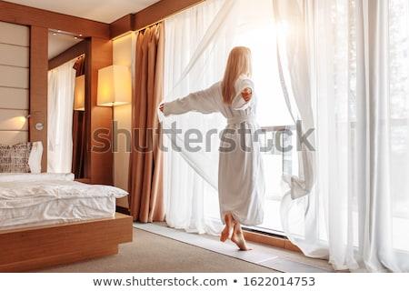 Stok fotoğraf: Bornoz · kadın · güneşli · pencere · beyaz · perde