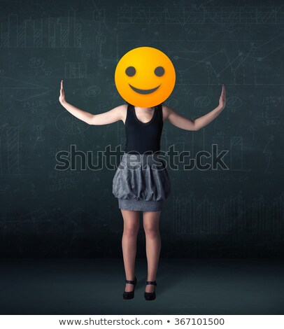 businesswoman wears yellow smiley face stock photo © ra2studio