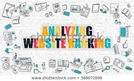 Analyzing Website Ranking on White Brick Wall. Stock photo © tashatuvango
