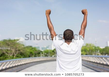 человека оба рук молодым человеком Сток-фото © feedough
