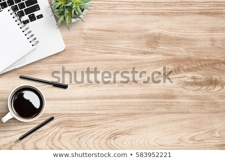 office desk with laptop coffee notepad and plant stock photo © karandaev