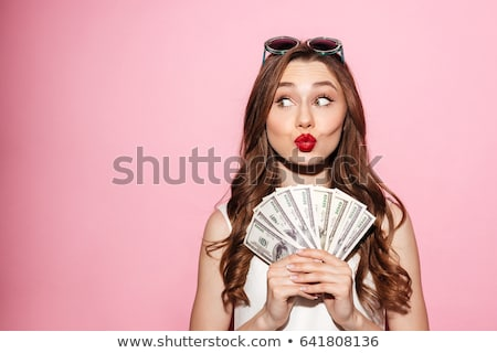 attracive happy young woman holding pink sunglasses stock photo © deandrobot