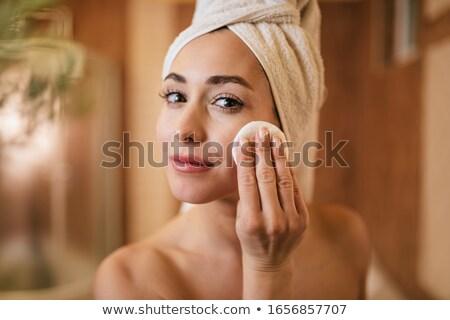 Femme nettoyage visage coton peignoir isolé Photo stock © deandrobot