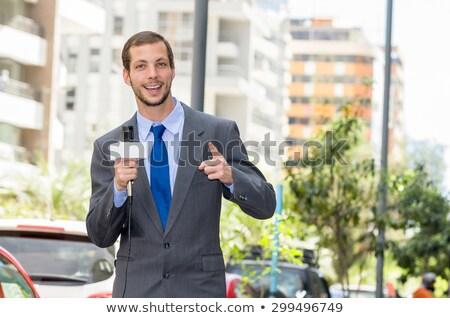 Male reporter holding camera Stock photo © deandrobot