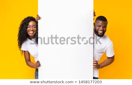 A handsome man with an empty signboard Stock photo © bluering