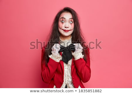 Young brunette beauty over dark mysterious background Stock photo © konradbak