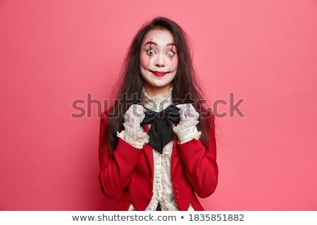 young brunette beauty over dark mysterious background stock photo © konradbak