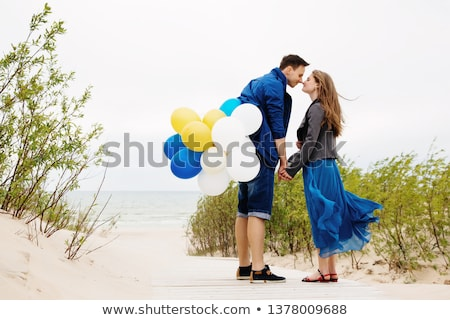 Young couple in love walking at the wooden sea pier Stock photo © deandrobot