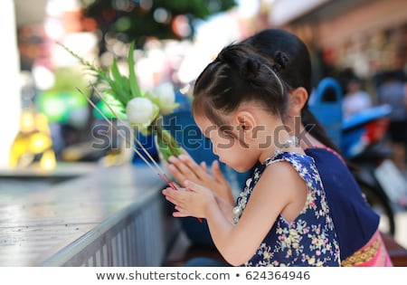 Buddhist child praying at the Temple Stock photo © adrenalina
