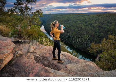 Felfedez naplemente kék hegyek terjedelem hátizsák Stock fotó © lovleah