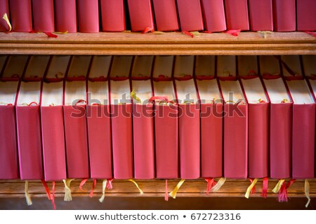 Stack of red bible books in church. Sweden, Europe Stock photo © kyolshin