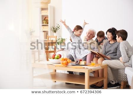 aile · oturma · odası · kek · gülen · kadın · kız - stok fotoğraf © monkey_business