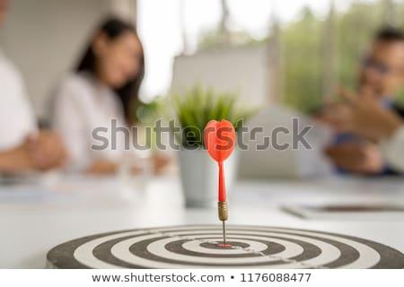 Jovem mulher de negócios dardo conselho asiático em pé Foto stock © RAStudio