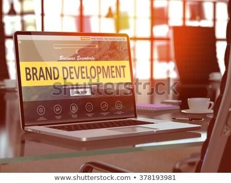 brand development concept on laptop screen 3d illustration stock photo © tashatuvango