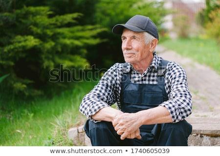 joyful old man in a baseball cap Stock photo © studiostoks