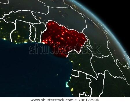 Nigeria on globe in red Stock photo © Harlekino