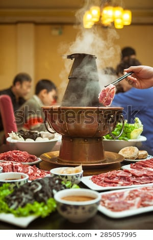 mutton slices cooked in hot pot Stock photo © devon