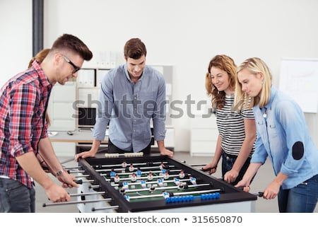 Group of five people playing football Stock photo © IS2