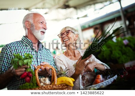 Man and woman with basket Stock photo © IS2