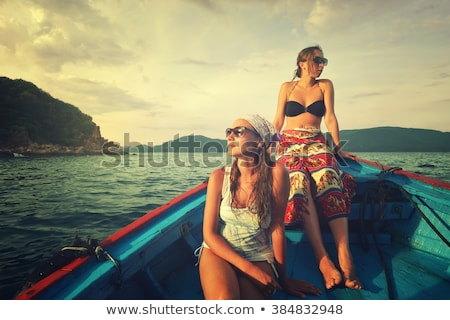 2 women swimming to boat Stock photo © IS2