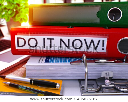do it now on file folder blurred image stock photo © tashatuvango