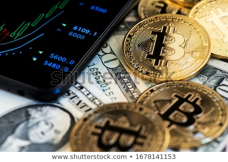 bitcoin on background of dollars stock photo © OleksandrO