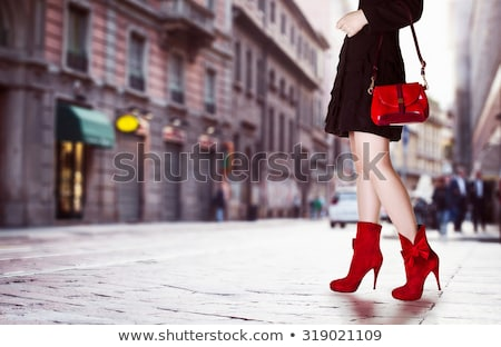 Stock photo: young woman in shorts and high heels walking