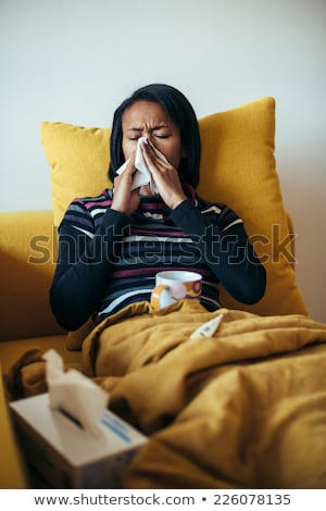 Jóvenes enfermos mujer sonarse la nariz papel servilleta Foto stock © RAStudio