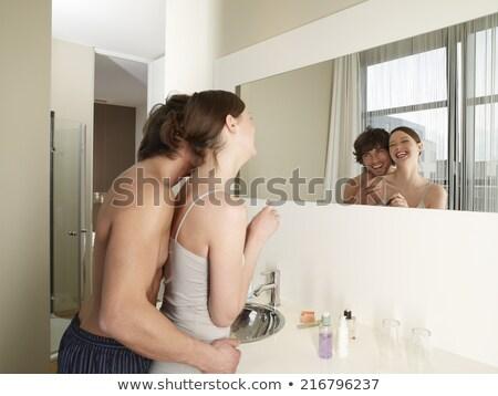 mulher · jovem · banheiro · balança · feminino · sorridente · estômago - foto stock © is2