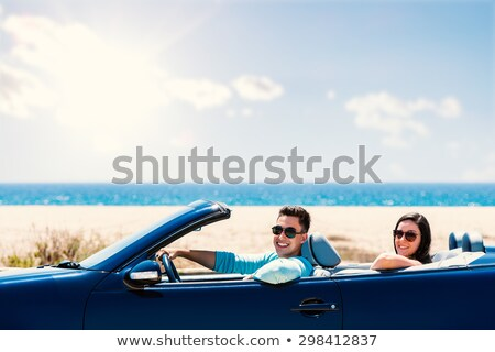 Young man driving convertible car, close up Stock photo © IS2