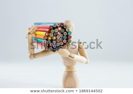 Wooden figurine carrying bunch of pencils Stock photo © wavebreak_media