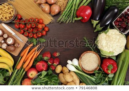 pasta vegetable salad and other food on table stock photo © dolgachov