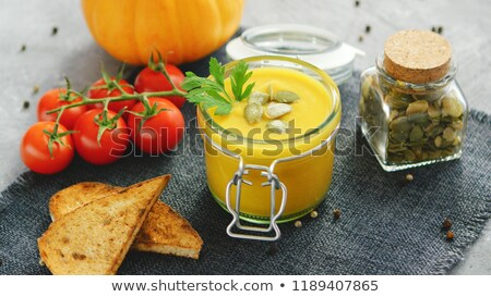 Сток-фото: сливочный · тыква · суп · банку · хлеб · помидоров