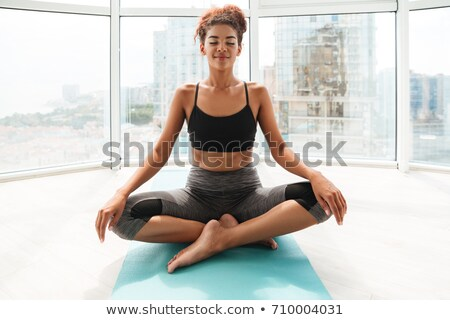 Full length image of Calm sports woman doing fitness exercise Stock photo © deandrobot
