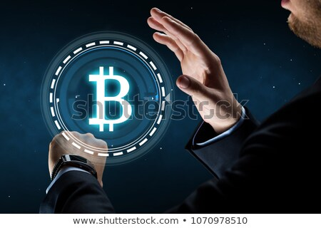 businessman with smart watch and bitcoin hologram stock photo © dolgachov