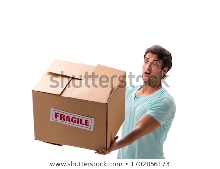 young handsome man with fragile box ordered from internet stock photo © elnur