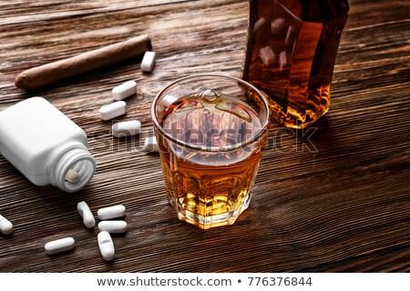 şişe alkol hapları tablo ilaç taciz Stok fotoğraf © dolgachov