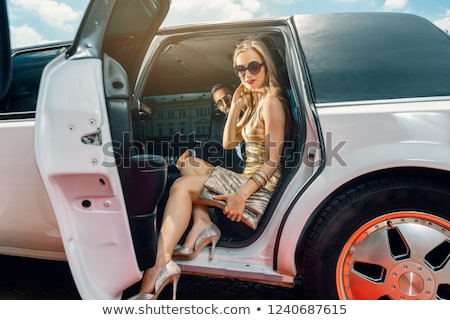 VIP Woman and man getting out of limousine Stock photo © Kzenon