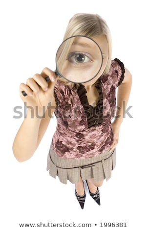Magnifying glass examines the idea of a young businesswoman Stock photo © alphaspirit