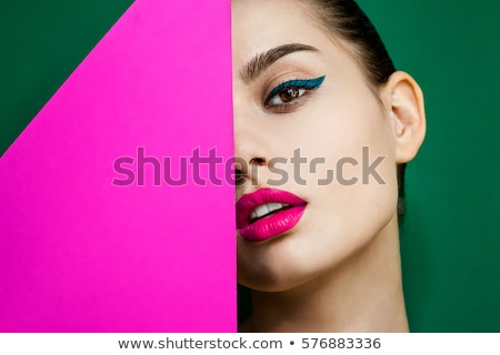 Portrait of a funny young girl with bright makeup Stock photo © deandrobot