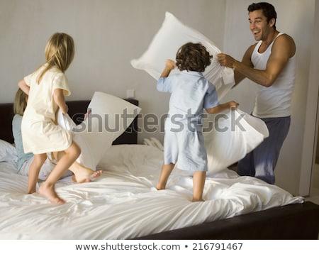 Children pillow fight at night Stock photo © colematt