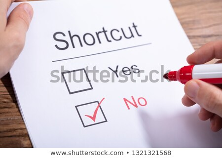 Person Holding Marker Over Paper With Shortcut Word Stock photo © AndreyPopov