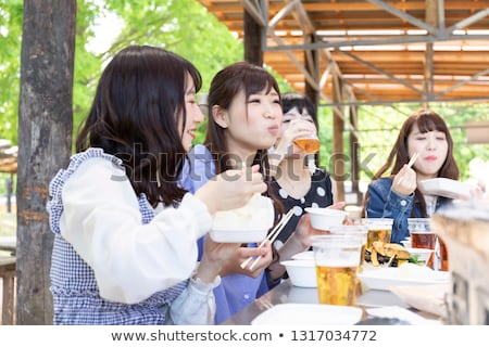 Group of young people enjoying barbecue party in the nature stock photo © boggy