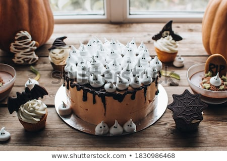 halloween party cupcakes and candies on table stock photo © dolgachov