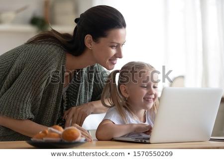 bella · ragazza · utilizzando · il · computer · portatile · home · internet · laptop - foto d'archivio © dashapetrenko