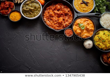 Assorted indian food on stone background. Dishes of indian cuisine Stock photo © dash