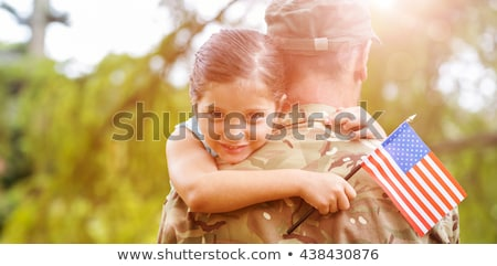 Patriotic holiday. Happy kid with American flag Stock photo © choreograph