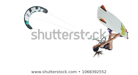 Sport girl on kite surfing Stock photo © jossdiim